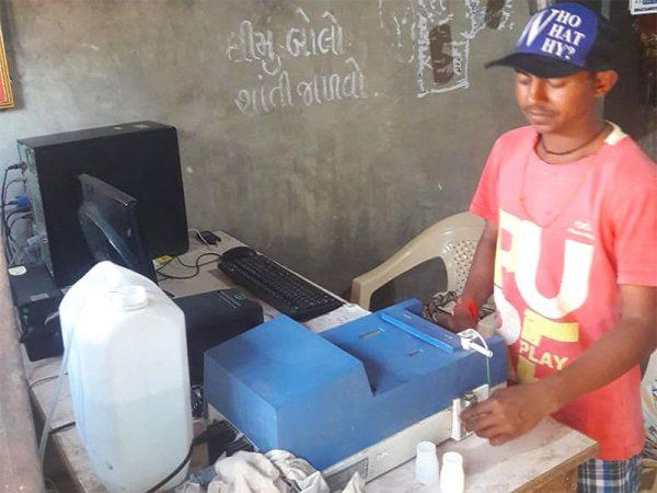 Testing the milk using a Milko Tester.