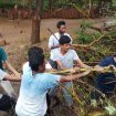 Internship Students Repair Roof for Tuition Children